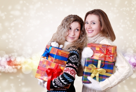 Happy smiling girlfriends with christmas presents photo