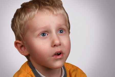 Crying boy portrait on light gray background Stock Photo - 14767548