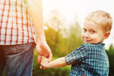 Father and son holding hand in hand Stock Photo