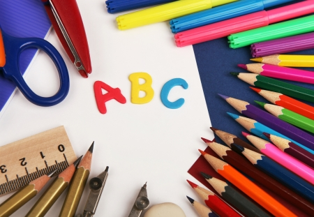 Background with school stationery and alphabet letters ABC photo