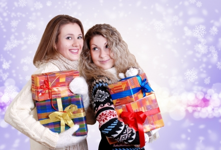 winter sales: Happy smiling girlfriends with christmas presents