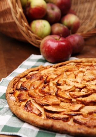Close up image open apple pie on the wooden ta,le with fresh apples photo