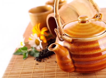 Still life with chenese tepot, cups; flowers and mint Stock Photo - 15714800
