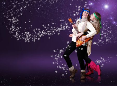 abstract dance: Beauty girls with balalika dancing over purple background with snow flakes