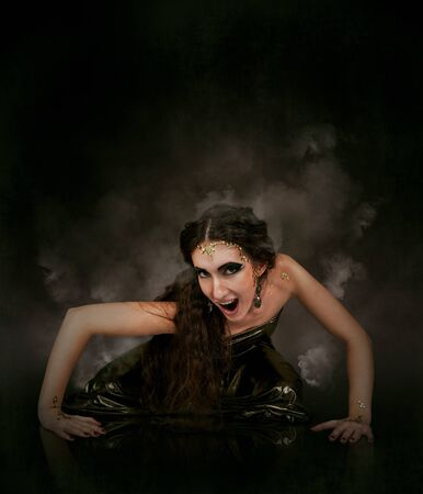 Dark abstract background with girl in snake medusa image Stock Photo - 16545579