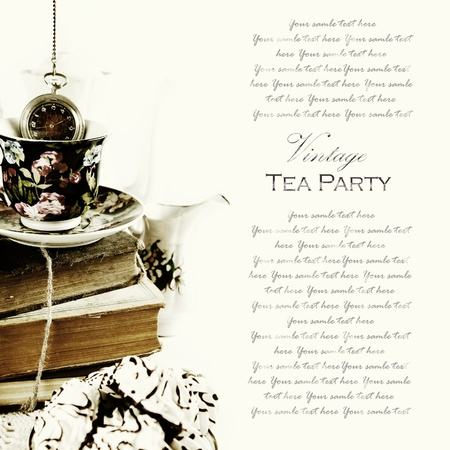 teacup: Vintage traditional english tea party background with old books and pocket watch