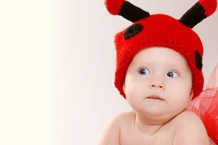 Little girl in funny hat with comic facial expression Stock Photo - 16909463