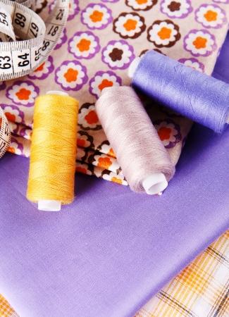 sartorial: Close up image of three spools colored therad Stock Photo