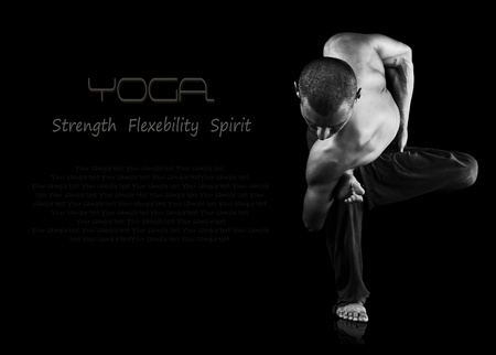 Blac and white image of flexible strong man doing yoga exercise photo