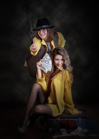 Two beauty swindler girls with case of money photo