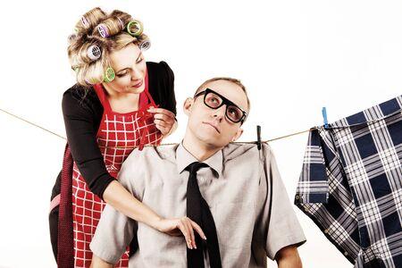submissive: Concept family scene. Careful houswife washong his husband