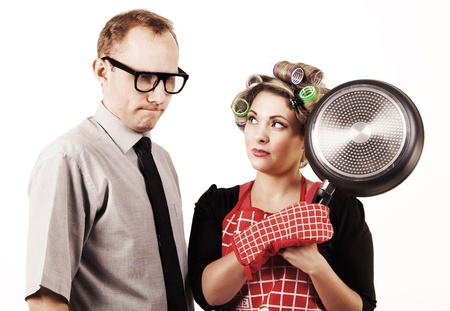 submissive: Serious talking. Danger housewife with pan and accused husband Stock Photo