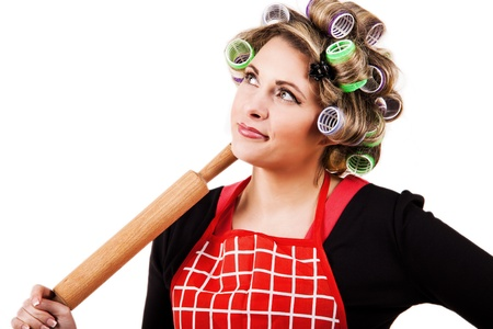Housewife portrait with rolling-pin on whhite background photo