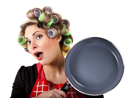 curlers: Pretty hosewife with comical surpised face expression
