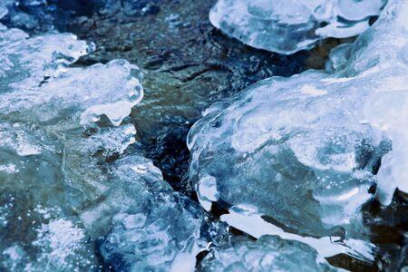 ice crust: Closeup image of winter river stream under crust of ice