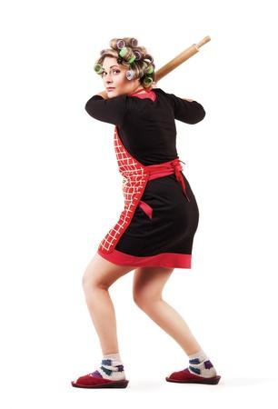 hair rollers: Comic scene - housewife like  baseball batter player  Stock Photo