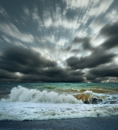 View of Sea surf stormy landscape with cloudy sky photo