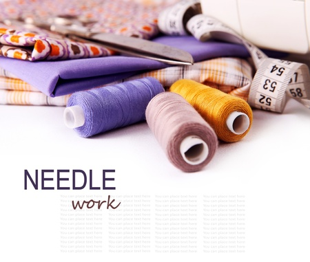 fabric roll: Sewing background with color threads, meter and scissors