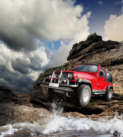 adventure sports: Offroad vehicle on the wild nature mountain terrain