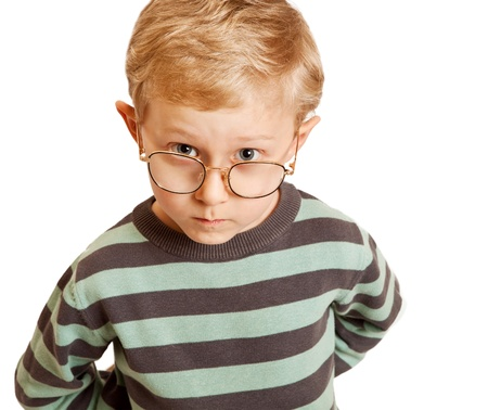 questioning: Serious boy portrait in eyeglasses Stock Photo