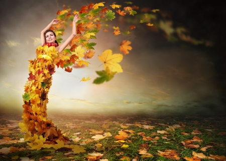 Lady Autumn with wings from falling leaves photo