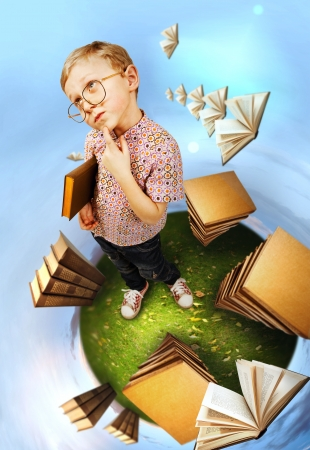 egghead: Clever little boy in glasses standing on abstract book planet