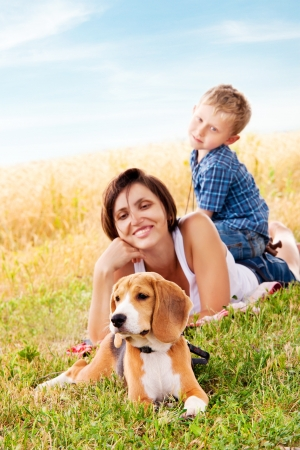 Mother and son have a nice leisure moment on the walk with his pet photo