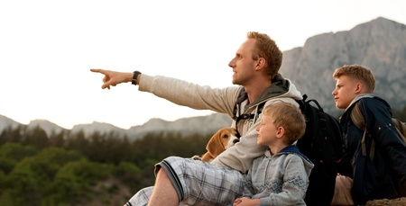 dog rock: Father with sons have active leusure with climbing