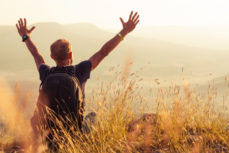 risk free: Feeling freedom man greeting golden rising of the sun Stock Photo