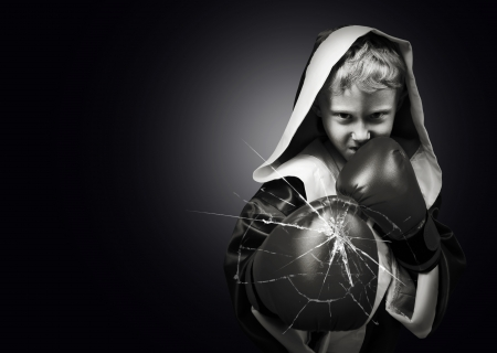 white glove: Danger young boxer fighter kick camera lens black and white image Stock Photo