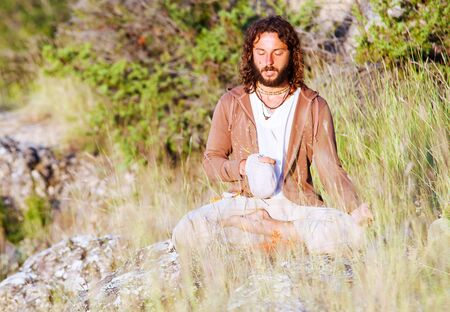master: Alone buddhism prayer greeting a rising sun