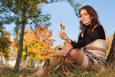 beuty of nature: Young woman enjoy autumn beuty nature sitting in the park Stock Photo