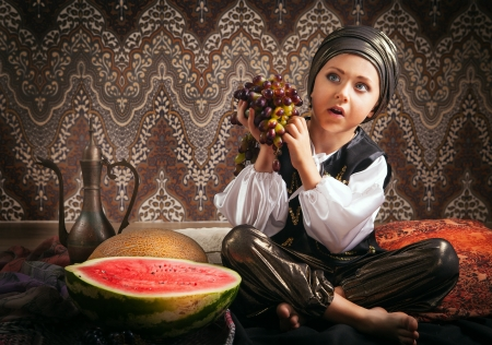 Prince from East fary tale with fruits photo