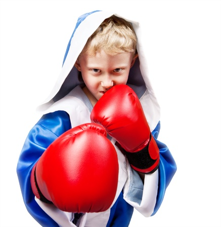 boy boxing: Boxing boy in red gloves on white background Stock Photo