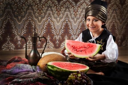 Little boy in arabian dress with ripe watermelon photo