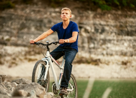 concetrated: Extreme mountain biking young man concetrated riding his bike