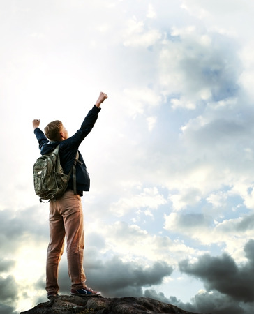 triumphing: Triumphing young man on the top of mountain