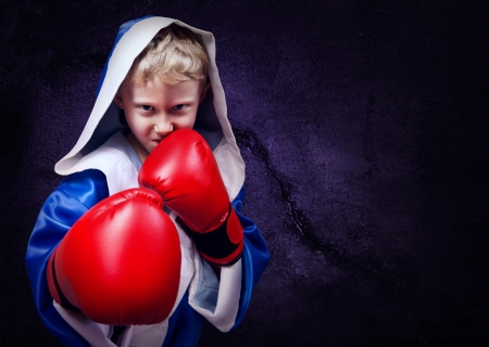 boy boxing: Boxing fighter boy portait on the purple wall background Stock Photo