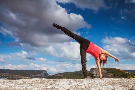 half: Yoga outdoor practice  Half moon yoga pose Stock Photo