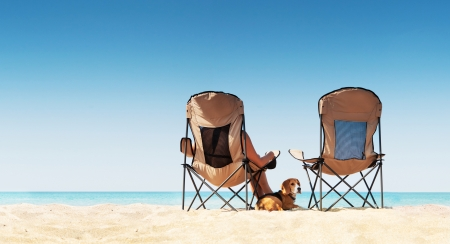 Love couple relaxing on the white sand beach with little beagle puppy dog photo