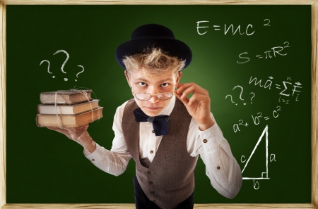 formulas: Questioning looking young man with old books near chalkboard