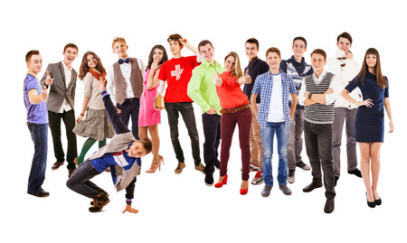 Large group of happy multicolored dressed teenagers on the white photo