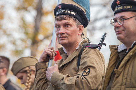 DNIPRODZERZHYNSK, UKRAINE - OCTOBER 26    Member of Historical reenactment in Soviet Army uniform after battle on October 26,2013 in Dniprodzerzhynsk, Ukraine  Dniprodzerzhynsk Liberation Day 2013