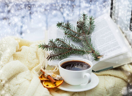 Romantic christmas still ife with cup of coffee and aromatic decoration photo