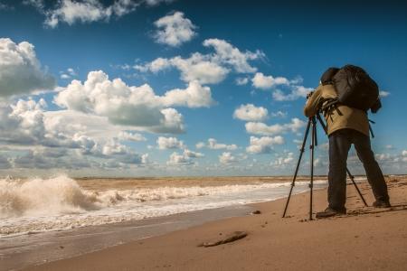 Landscape photographer work on sea coast photo