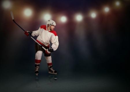 Ice Hockey player ready to make a snapshot