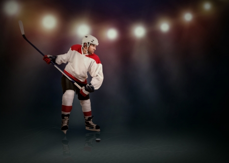Ice Hockey player ready to make a snapshot photo