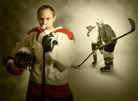 Ice hockey players on dramatick background photo