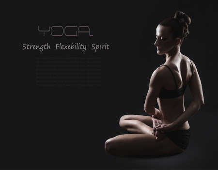 Black yoga with slim woman photo