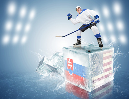 Slovakia - USA game  Spunky hockey player on ice cube photo